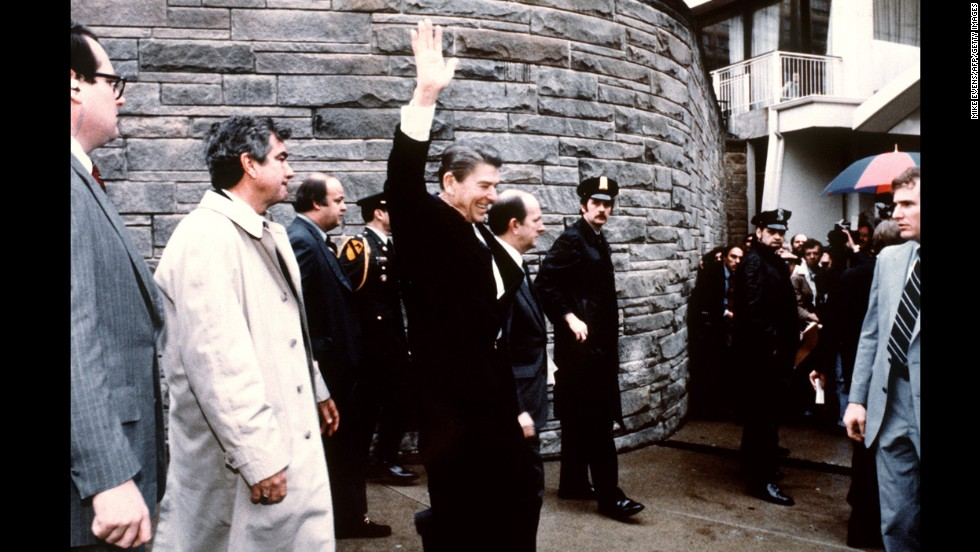 On March 30, 1981, six shots were fired at President Ronald Reagan outside the Hilton Hotel in Washington. The shooter, John Hinckley, was taken to the ground immediately.  This photo taken by presidential photographer Mike Evens captures Reagan waving to the crowd moments before the attempted assassination.