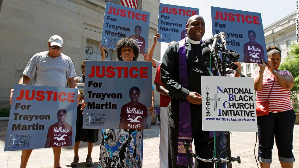 Outside the Department of Justice in Washington on July 15, Rev. Anthony Evans, president of the National Black Church Initiative, leads a prayer during a demonstration asking for justice for Trayvon Martin.