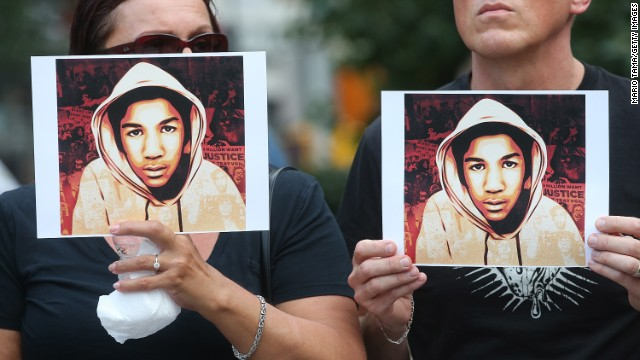 People hold photos of Trayvon Martin at a rally honoring Martin at Union Square in Manhattan on July 14, 2013 in New York City. George Zimmerman was acquitted of all charges in the shooting death of Martin July 13 and many protesters questioned the verdict.