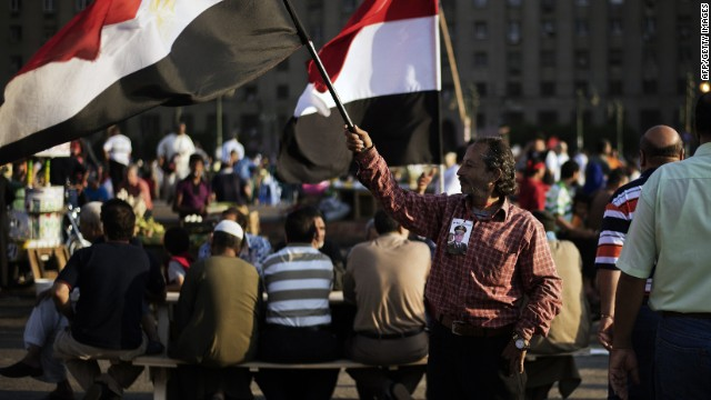 Opponents of ousted President Mohammed Morsy gather in Egypt's landmark Tahrir square to break their fast in Cairo on July 12, 2013.