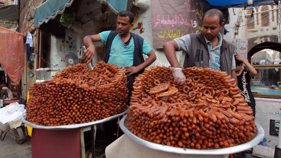 Street vendors sell sweets in Sanaa, Yemen, on Monday, July 15.