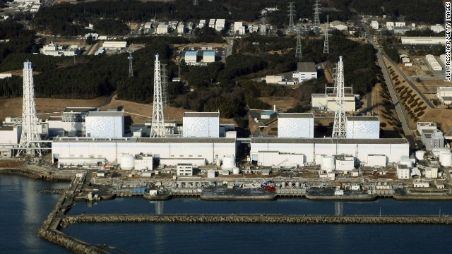 An aerial view shows the quake-damaged Fukushima nuclear power plant in the Japanese town of Futaba, Fukushima prefecture on March 12, 2011. Japan scrambled to prevent nuclear accidents at two atomic plants where reactor cooling systems failed after a massive earthquake, as it evacuated tens of thousands of residents. Tokyo Electric Power, which runs the plants, said it had released some radioactive vapour into the atmosphere at one plant to relieve building reactor pressure, but said the move posed no health risks. AFP PHOTO / JIJI PRESS        (Photo credit should read JIJI PRESS/AFP/Getty Images)
