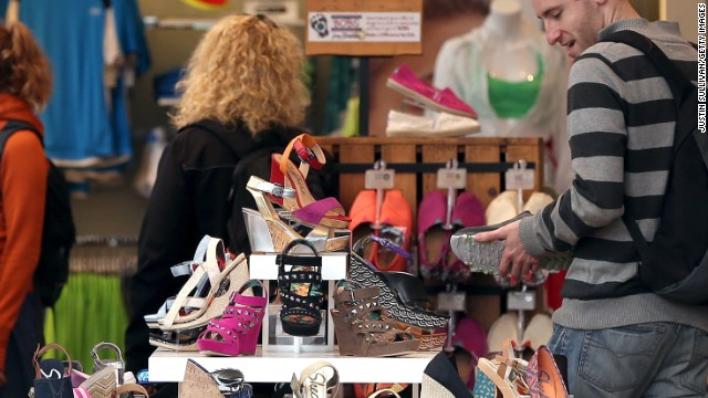 Customers look at shoes in San Francisco. Peggy Drexler says it's not bringing purchases home, it's the experience.