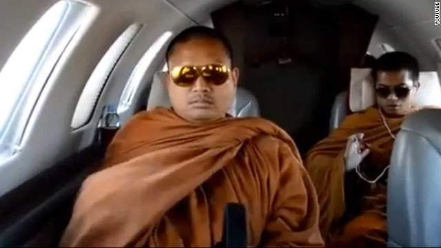 Still taken from amateur footage posted on YouTube purportedly shows Luang Pu Nenkham (L) on a private jet.