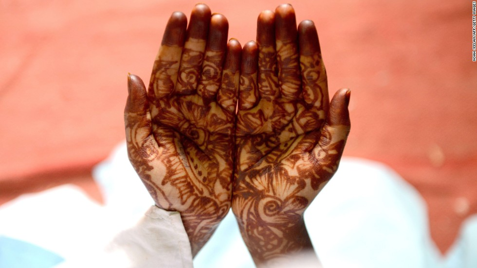 A girl holds out her hands during Dua prayers on July 17 at the school in Hyderabad.
