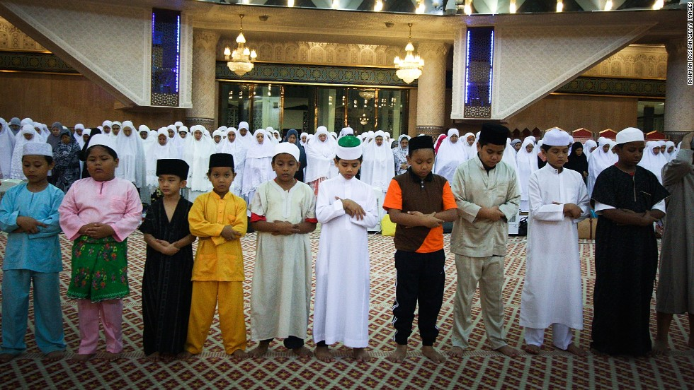 A row of children joins the night prayer known as Tarawih on Tuesday, July 16, in Kuala Lumpur, Malaysia.