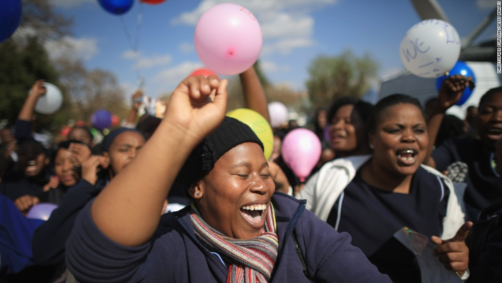 "JULY 18 - PRETORIA, SOUTH AFRICA: People gather in front of the Pretoria hospital where Nelson Mandela is being treated, as the world celebrates the former South Africa's <a href=""http://cnn.com/2013/07/18/world/africa/south-africa-mandela/index.html?hpt=iaf_c1"">president's 95th birthday</a>. Mandela has been in <a href=""http://cnn.com/2013/06/26/world/africa/mandela-hospital-messages/index.html?iid=article_sidebar"">the hospital since June 8</a>, suffering from a lung infection."
