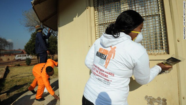 South Africans have been doing their part, like these government workers cleaning houses at a drug rehab center in Soweto.