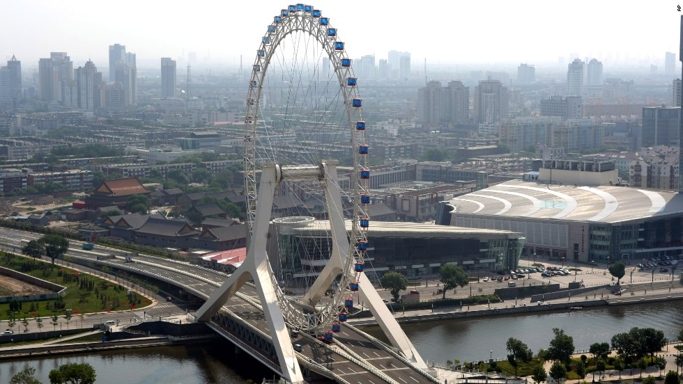 The Tianjin Eye, in its namesake city in northeastern China near Beijing, was built on a bridge across the Hai River. The wheel can hold 770 passengers in 48 capsules. Riders can get amazing views of the city and the cars on the highway below them during the 30-minute rotation.<br />
