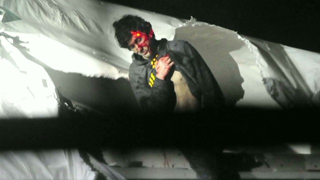 Bloody photos of Boston bombing suspect