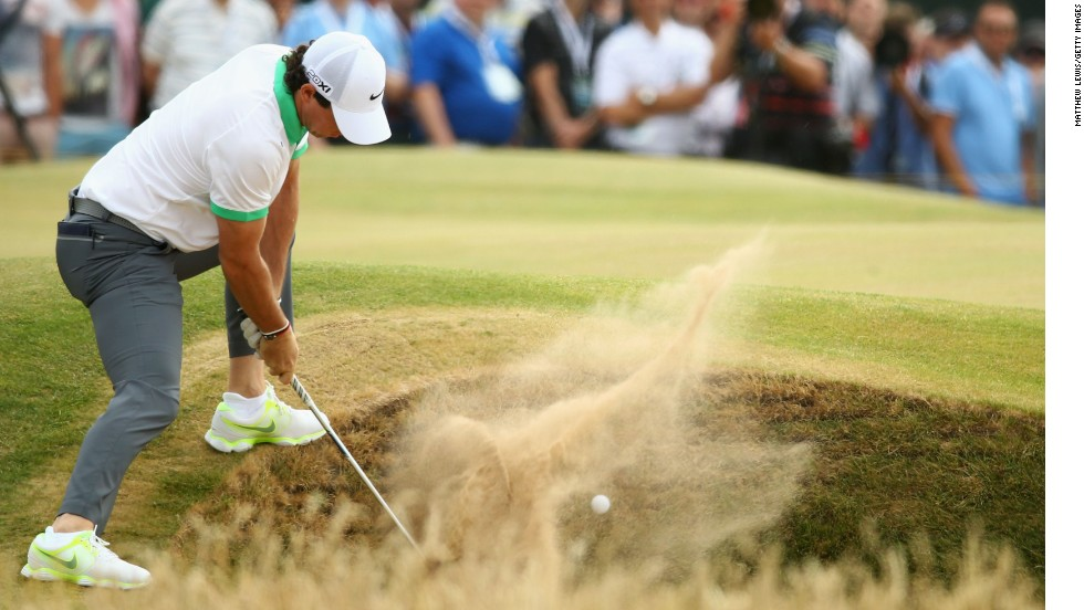 There was trouble in the bunkers for McIlroy. He escapes here but at the 15th he putted from the green into a bunker on his way to a second double-bogey of the day.