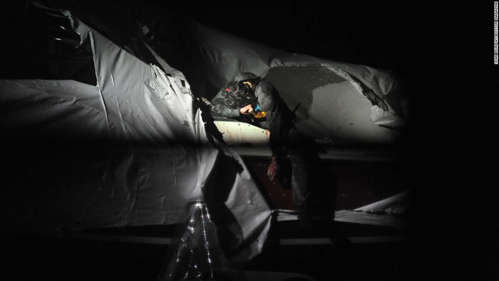 Tsarnaev exits the boat during his capture.  The pictures were taken by Murphy and published online by Boston Magazine.