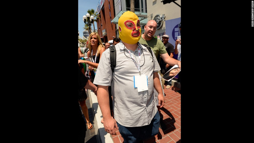 A masked Jack Black walks down the street as fans ask for his autograph on July 18.