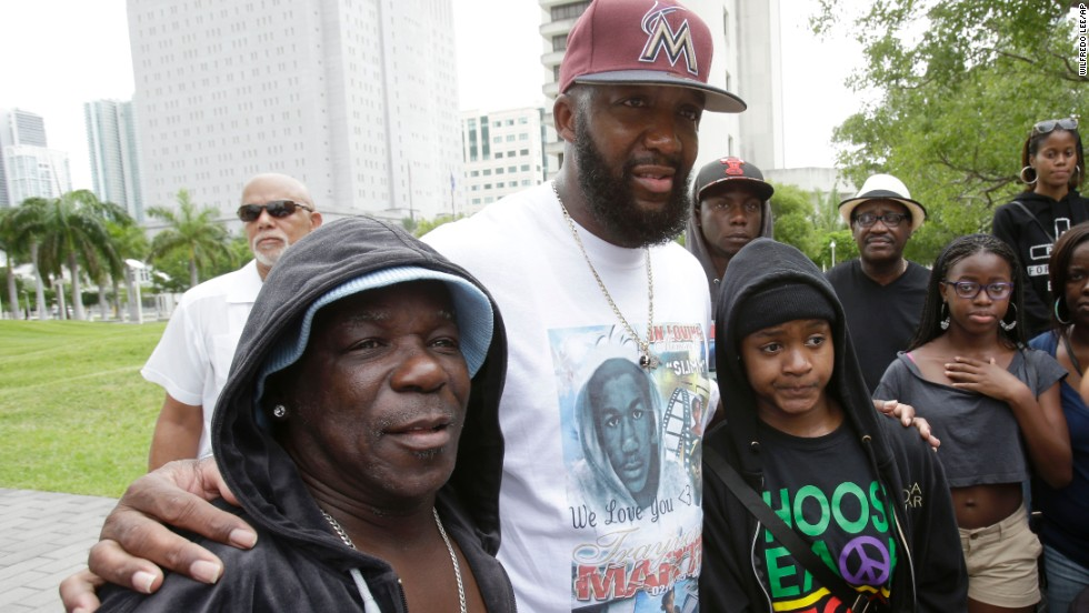 Tracy Martin, father of Trayvon Martin, poses for a photo with supporters wearing hoodies at the rally in Miami on July 20.