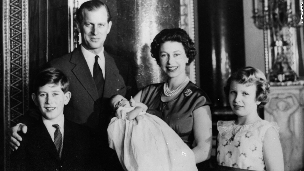 Queen Elizabeth II holds newborn Prince Andrew in the music room of Buckingham Palace in March 1960. Prince Charles, from left, Prince Philip and Princess Anne are by her side.