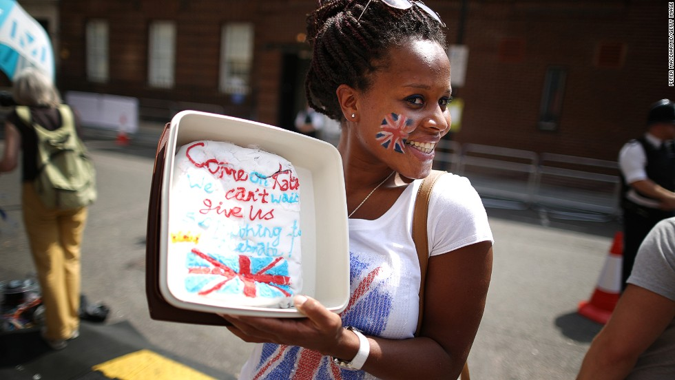 Royal fan Teba Diatta stands outside St. Mary's Hospital with a cake decorated for the occasion on July 22.
