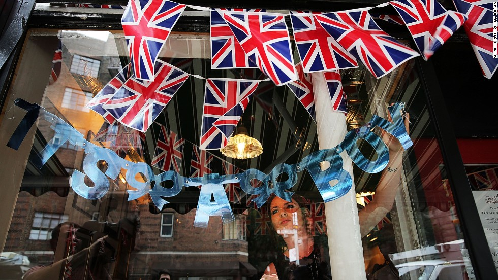 Hayley Simmonds, an employee at the British restaurant and grocery Tea & Sympathy, celebrates the birth on July 22 by hanging a sign in the store's window in New York.