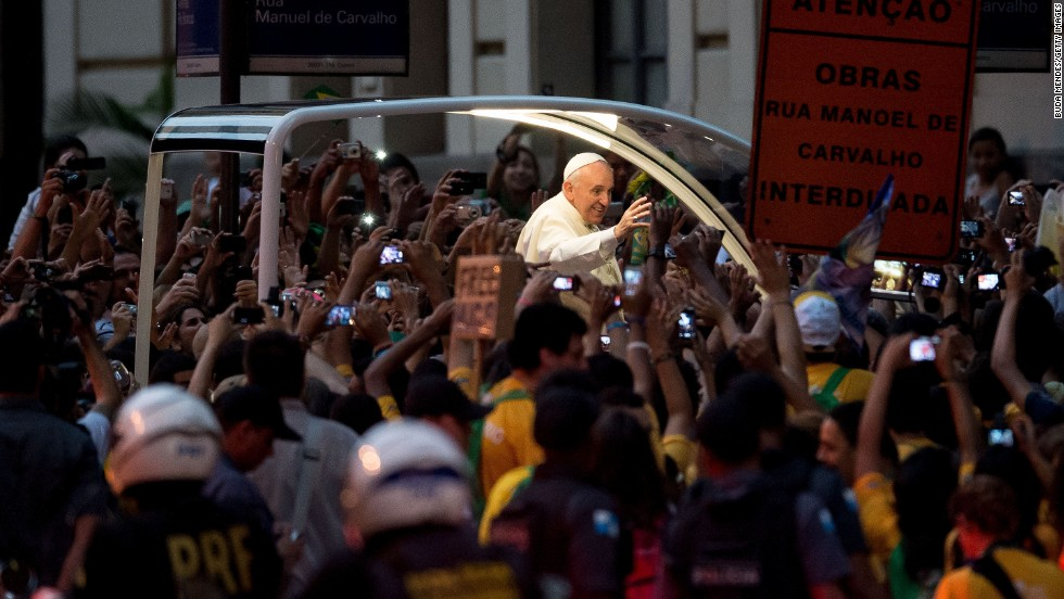 Pope Francis waves to supporters in Rio on July 22.