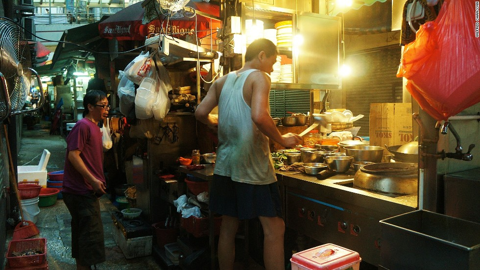 Street food chef Lam Tse-Sing prepares a meal at his dai pai dong, called Sing Kee, in Hong Kong's Central district. Despite their dwindling number, the outdoor street food stalls continue to be celebrated for their traditional flavor and festive atmosphere.