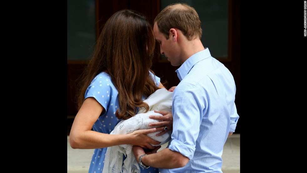 Catherine hands the baby off to William.