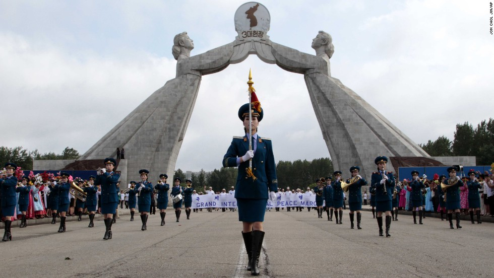 The North Korean military band leads an international peace march at the Three Charters for National Reunification Memorial Tower in Pyongyang on July 24. This was the first war in which the United Nations played a role and the first to battle with jet aircraft.