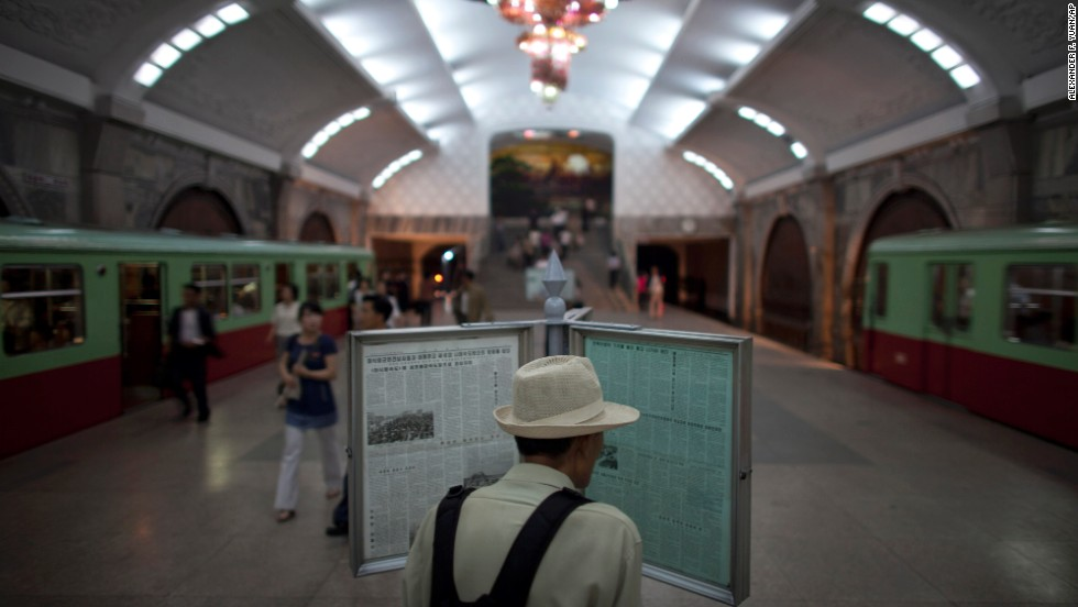 A man reads a newspaper on a public display at Puhung subway station in Pyongyang on Tuesday, June 18. Some stations are more elaborate than others and foreign visitors are usually only allowed to take one stop, from Puhung station to Yonggwang.