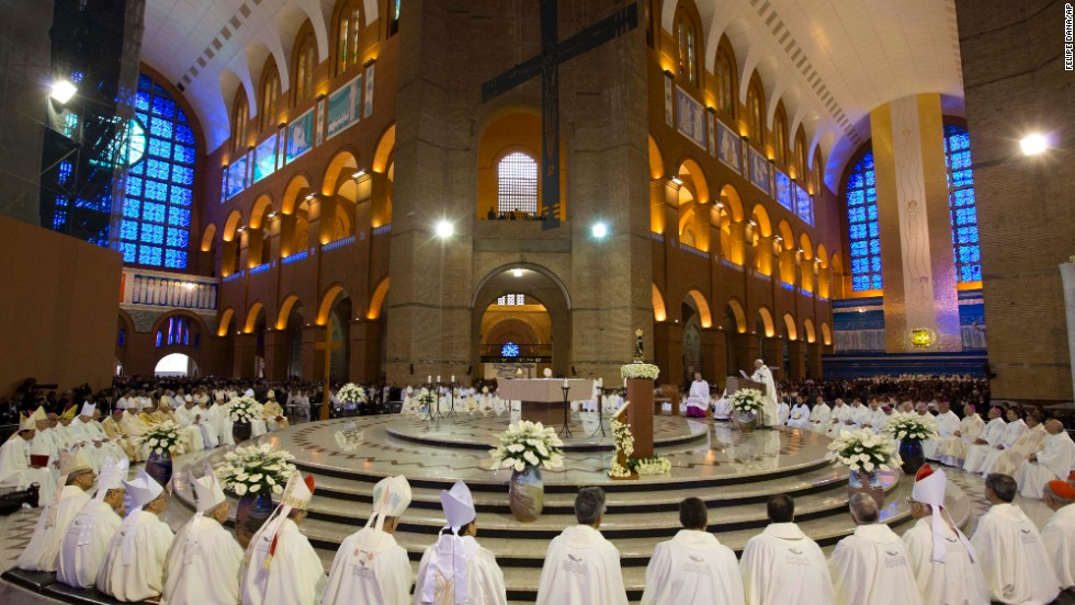 Members of the clergy listen to Pope Francis, center right, as he gives Mass inside the Basilica of Our Lady of Aparecida on July 24.