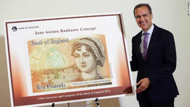 Governor of the Bank of England, Mark Carneystands poses with the concept design for the new Bank of England £10 banknote, featuring author Jane Austen.
