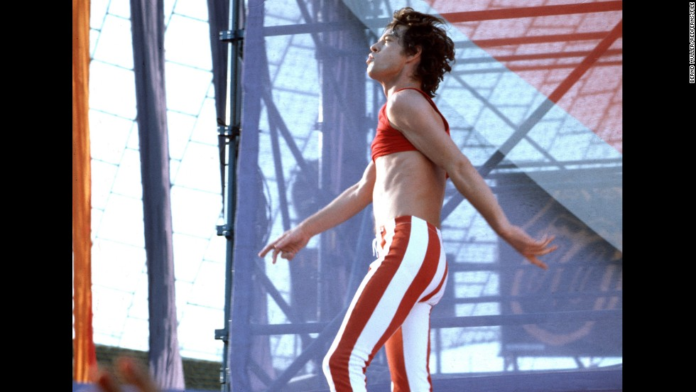 "In 2011, Maroon 5's Adam Levine paid homage to Jagger's vintage look -- such as this midriff-baring outfit from the Rolling Stones' 1982 European tour -- in the music video for ""Moves Like Jagger."" In it, Levine, too, slips into a pair of skintight skinnies and rocks out without a shirt."