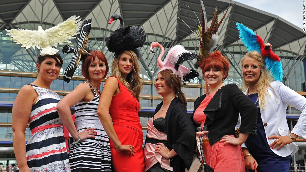 Pimms, pomp and circumstance. A group of young women sport an array of unusual hats at Royal Ascot's Ladies Day. Ascot is one of the key events on the English sport and social calendar.