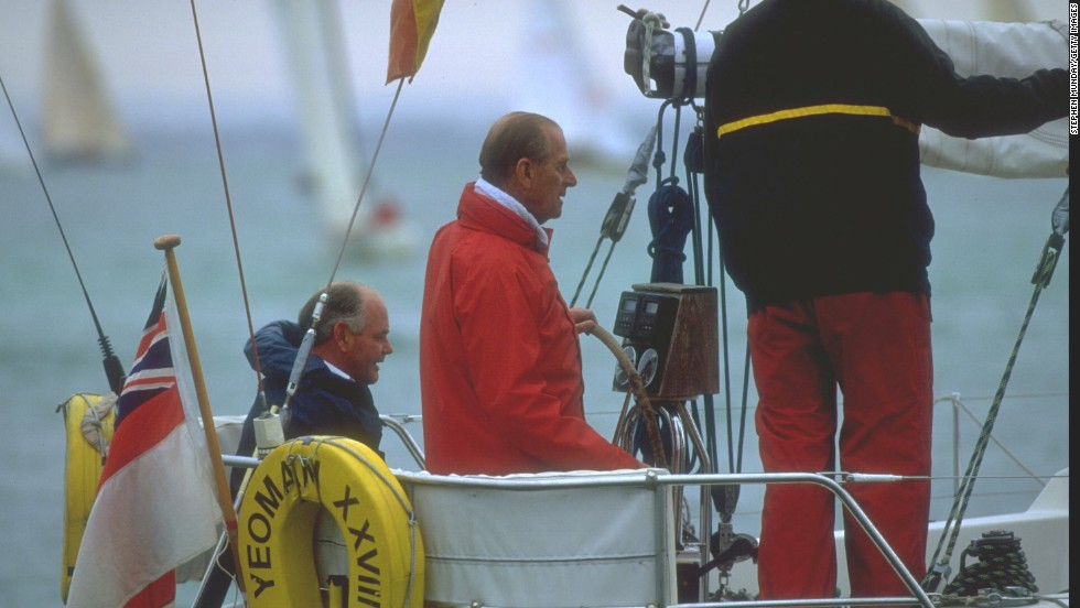 Royal patronage: The Duke of Edinburgh takes the helm as he takes part in the 1994 Cowes Week in southern England.