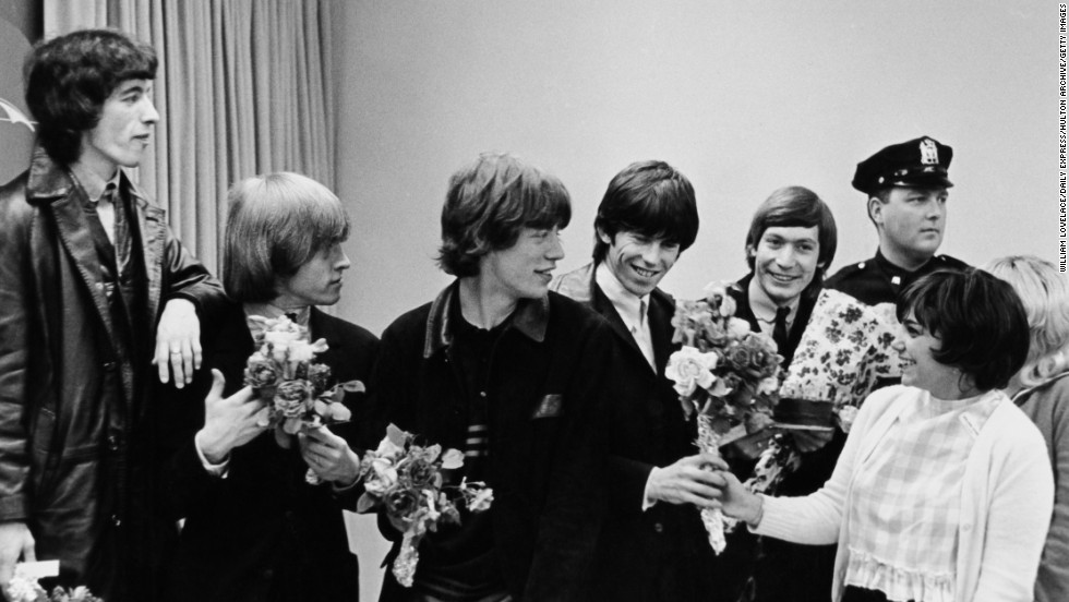 The Rolling Stones receive bouquets from fans in New York during their first U.S. tour in June 1964.