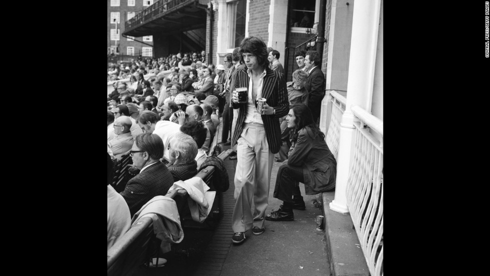 Mick Jagger returns to his seat during a cricket match between England and Australia in 1972.