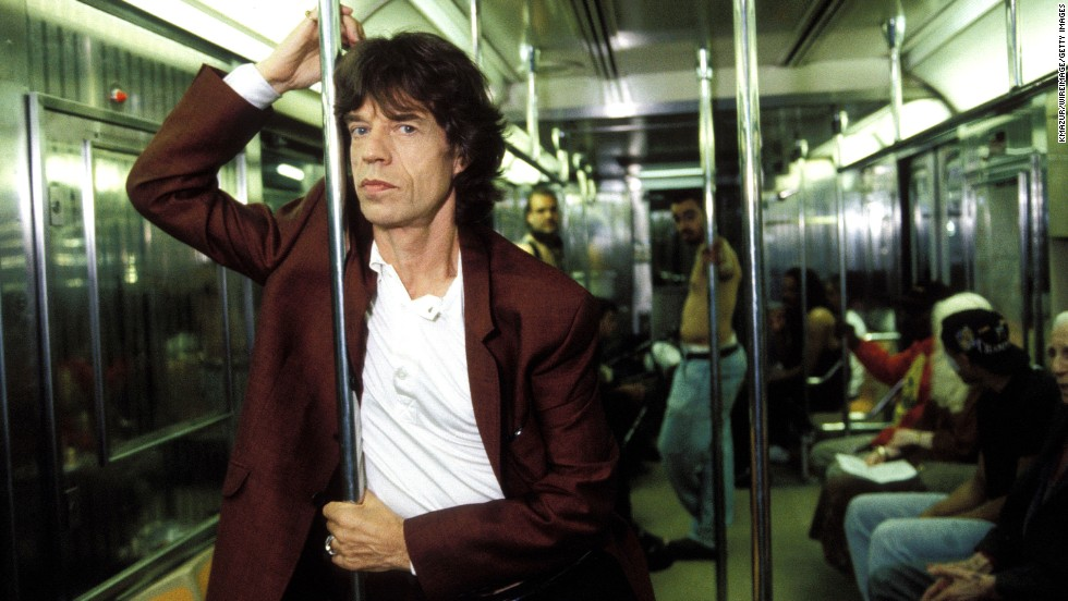 Mick Jagger has his picture taken on a subway in New York in 1997.