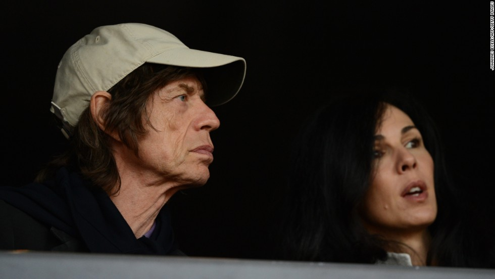 Mick Jagger watches the 2012 Olympic Games in London with his girlfriend, American fashion designer L'Wren Scott. Scott died in early 2014.