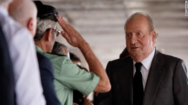Spain's king visits train crash survivors