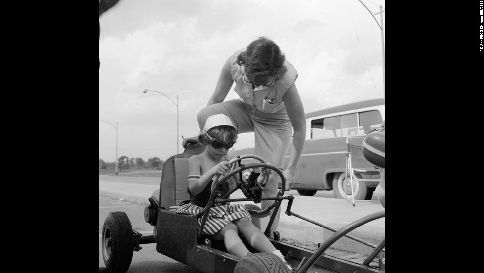 A mother gives her child advice during a boxcar race in Livonia, Michigan, a Detroit suburb, circa 1955. The move to the suburbs accelerated, especially after rioting that devastated Detroit in 1967.