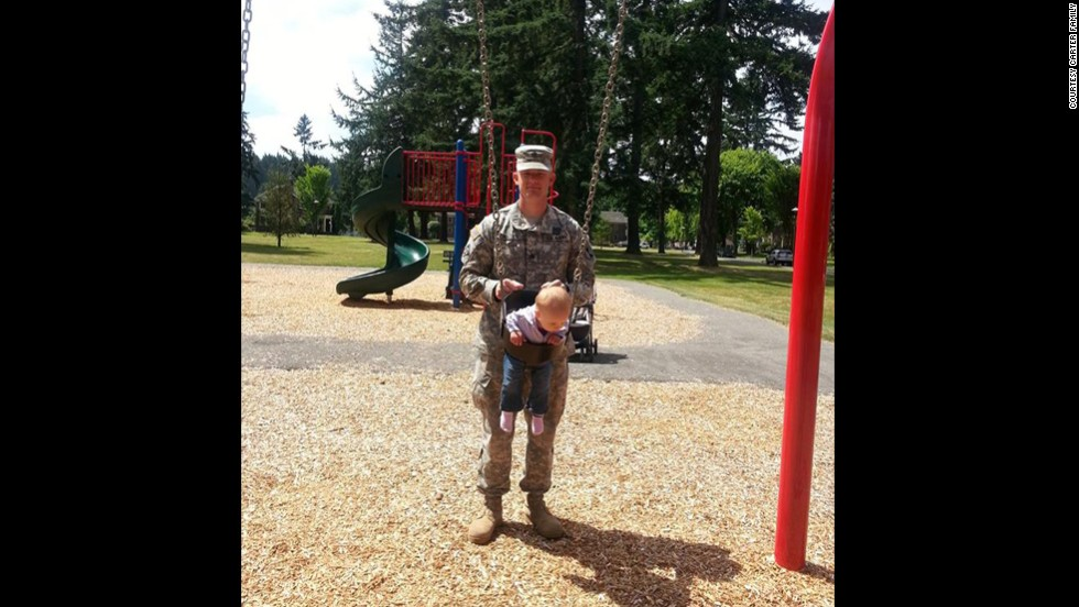 Carter plays with his daughter Sehara Carter at a park at Joint Base Lewis-McChord in Washington state in early July 2013.