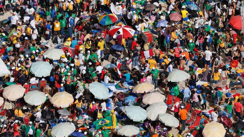 Catholic youths await the arrival of Pope Francis on Copacabana beach in Rio on July 26.