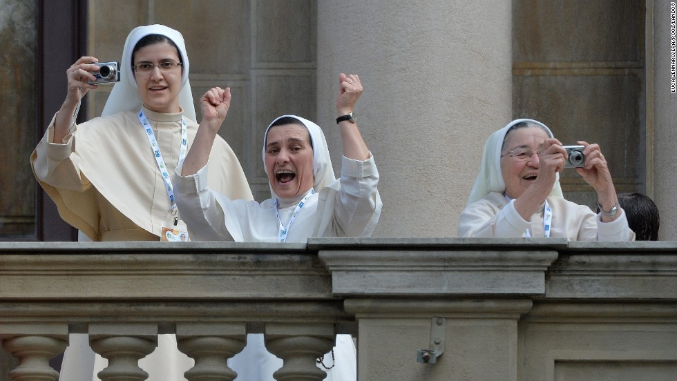 Nuns cheer and take photographs from the central balcony of the Archbishop's Palace in Rio as Pope Francis arrives for the Angelus Prayer on July 26.