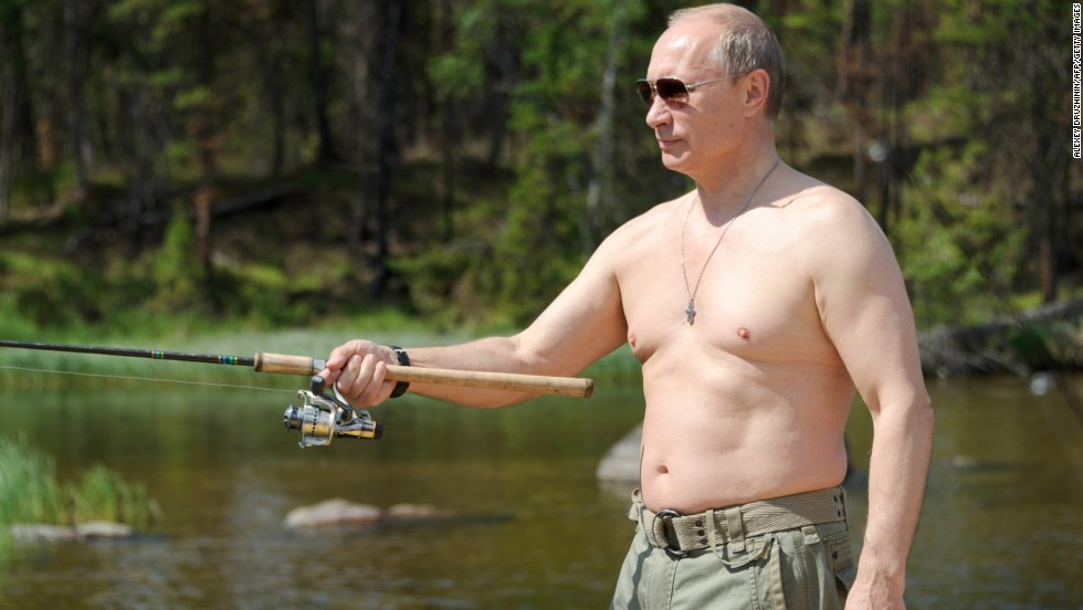 Putin enjoys some fishing during his vacation to the Tuva region on July 20, 2013.