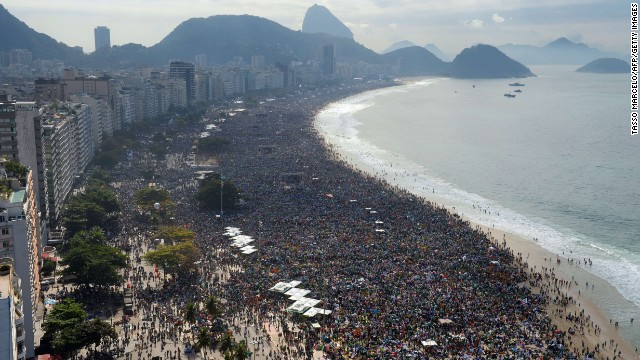 Hundreds of thousands of people crowd Copacabana Beach in Rio de Janeiro, Brazil on Sunday, July 28, as they wait for the arrival of Pope Francis for the final mass of his visit.