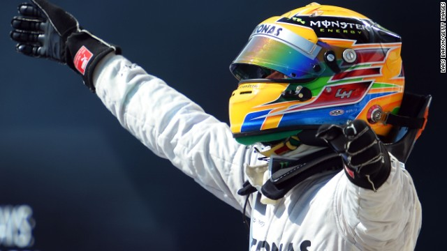 Lewis Hamilton celebrates his superb victory for Mercedes in the Hungarian Grand Prix in Budapest.