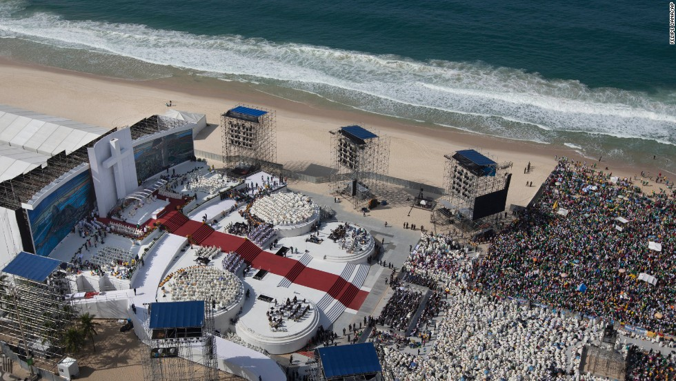 A bird's-eye view of the pope's stage is seen leading to a sea of priests dressed in white and then to the millions of faithful that turned out on Copacabana beach to witness the Mass.