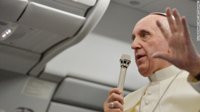 Pope Francis speaks during a long press conference held aboard the papal flight on their way back to Italy upon departure from Rio de Janeiro in Brazil, on July 28, 2013.