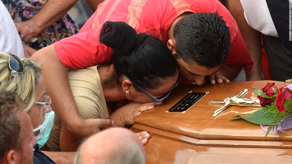 Relatives of a victim kiss a coffin on July 29 near a morgue in Monteforte Irpino.