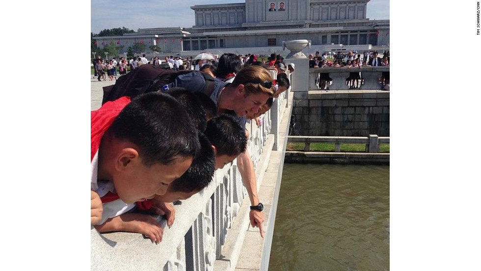 CNN's Ivan Watson looked at carp with Pyongyang schoolchildren at the park in front of Kim Il Sung and Kim Jong Il's final resting place.