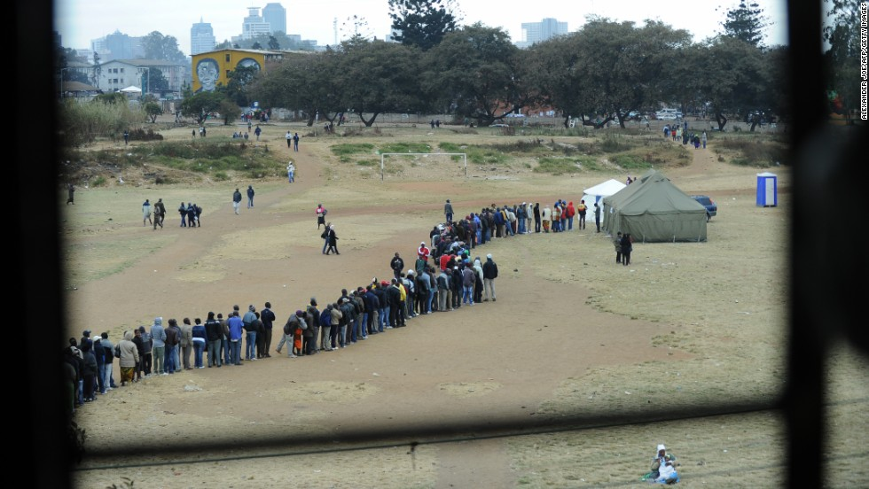 "July 31 - Harare, Zimbabwe: People line up to <a href=""http://cnn.com/2013/07/31/world/africa/zimbabwe-election/index.html?hpt=hp_t1"">vote in general elections</a>, as President Robert Mugabe seeks to extend his time in power to a potential 38 years. Mugabe, 89, has been in charge of the country since 1980 -- the only leader the nation has known since it gained independence. His main rival, Morgan Tsvangirai, is the current prime minister."