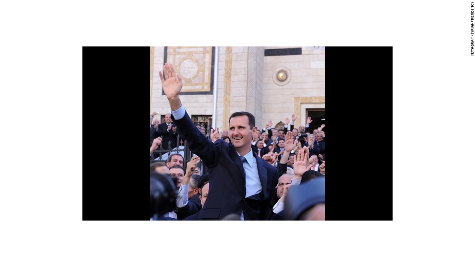 Al-Assad smiles and waves to what appears to be an appreciative crowd. Among his 69 posts so far, there's not a single battlefield in sight -- despite the civil war which has torn his country apart for more than two years.