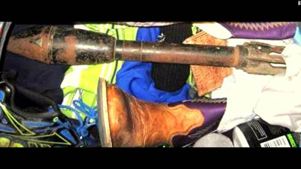 Law enforcement officers evacuated Dallas-Fort Worth's baggage area and the terminals near a bazooka round found in checked luggage. The item was moved to a remote location, where it was deemed inert.
